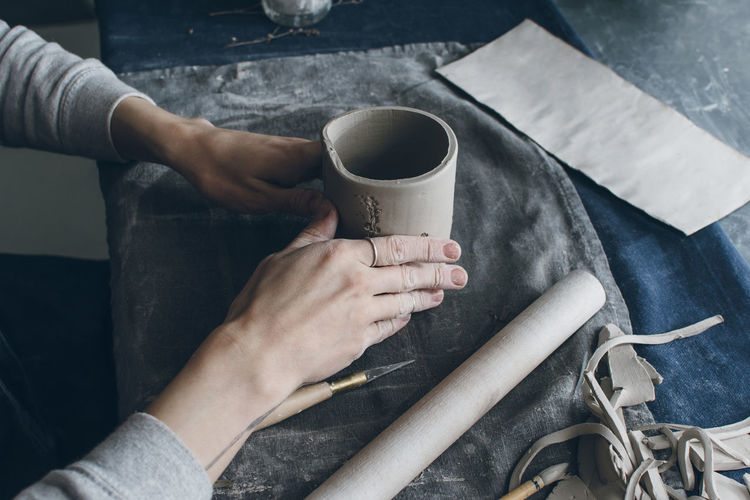 Business Hands At Work Sitting Studio Woman Working Workshop Clay Creative Cup Female Indoors  Mug One Person Owner Pottery Prepairing Real People Small Table Traditional