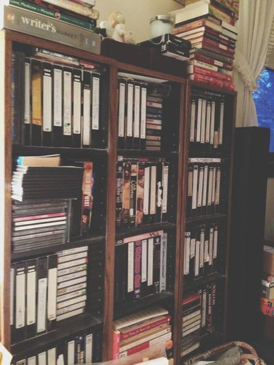 Books Casette Tapes Office Bookshelf Knick Knacks Storage Reading Movies Collection l VCR Tapes Traveling Home For The Holidays Bedroom Organization Organized Chaos Collection Clutter Media Shelves Bookcase At Home Home Books Memories