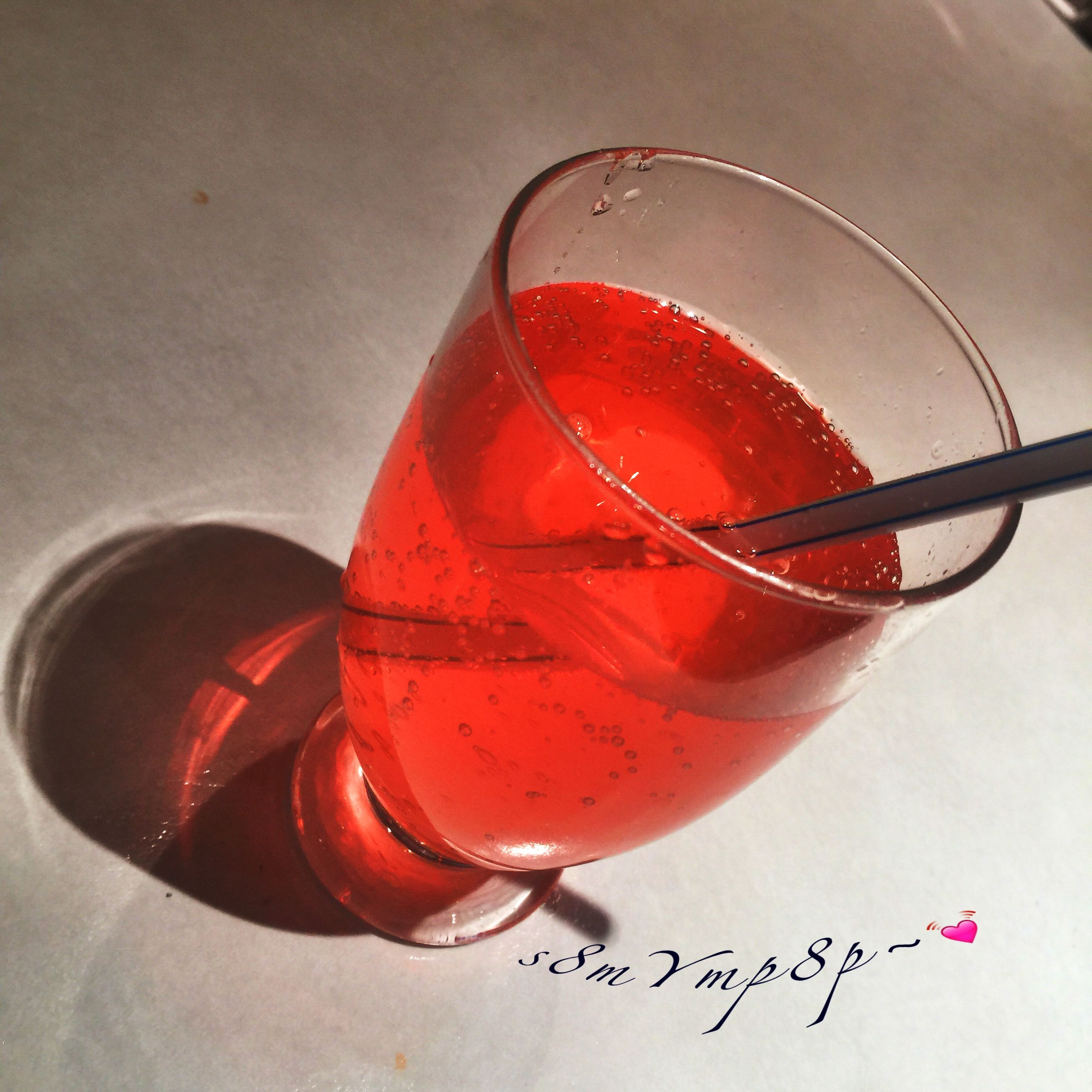 red, close-up, still life, indoors, food and drink, glass - material, high angle view, table, transparent, no people, reflection, day, cold temperature, text, heart shape, drink, communication, wet, focus on foreground, pink color