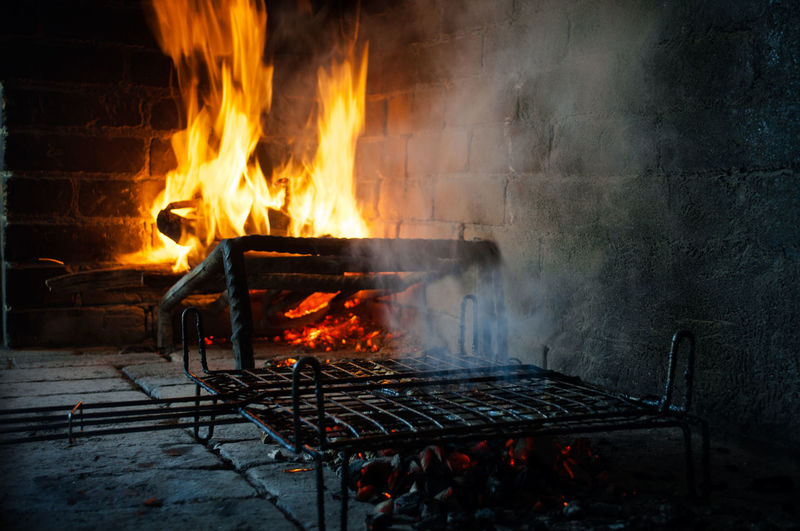 View of fire on barbecue grill