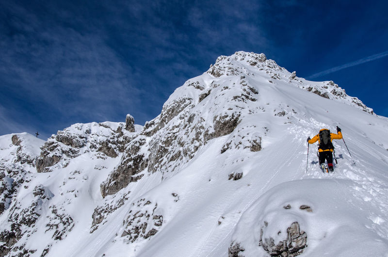 Adventure Club Person In Nature Ski Mountaineering Climbing A Mountain Snow Alpinism Warm Clothing Unrecognizable Person Landscape Cloud - Sky