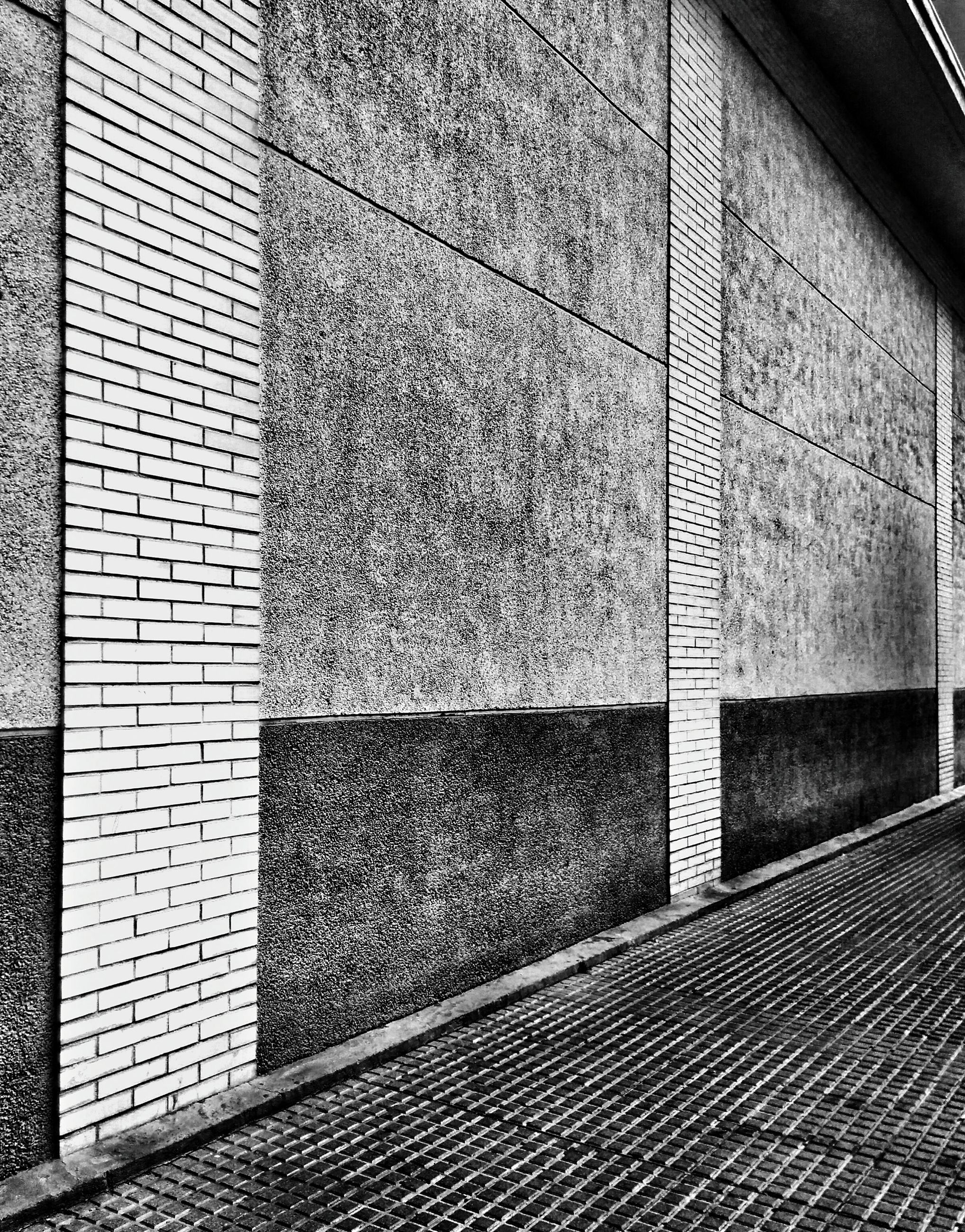 architecture, built structure, pattern, building exterior, wall - building feature, steps, indoors, design, sunlight, steps and staircases, day, no people, shadow, railing, textured, staircase, building, high angle view, wall, brick wall