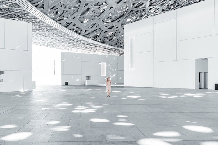Woman walking in modern building