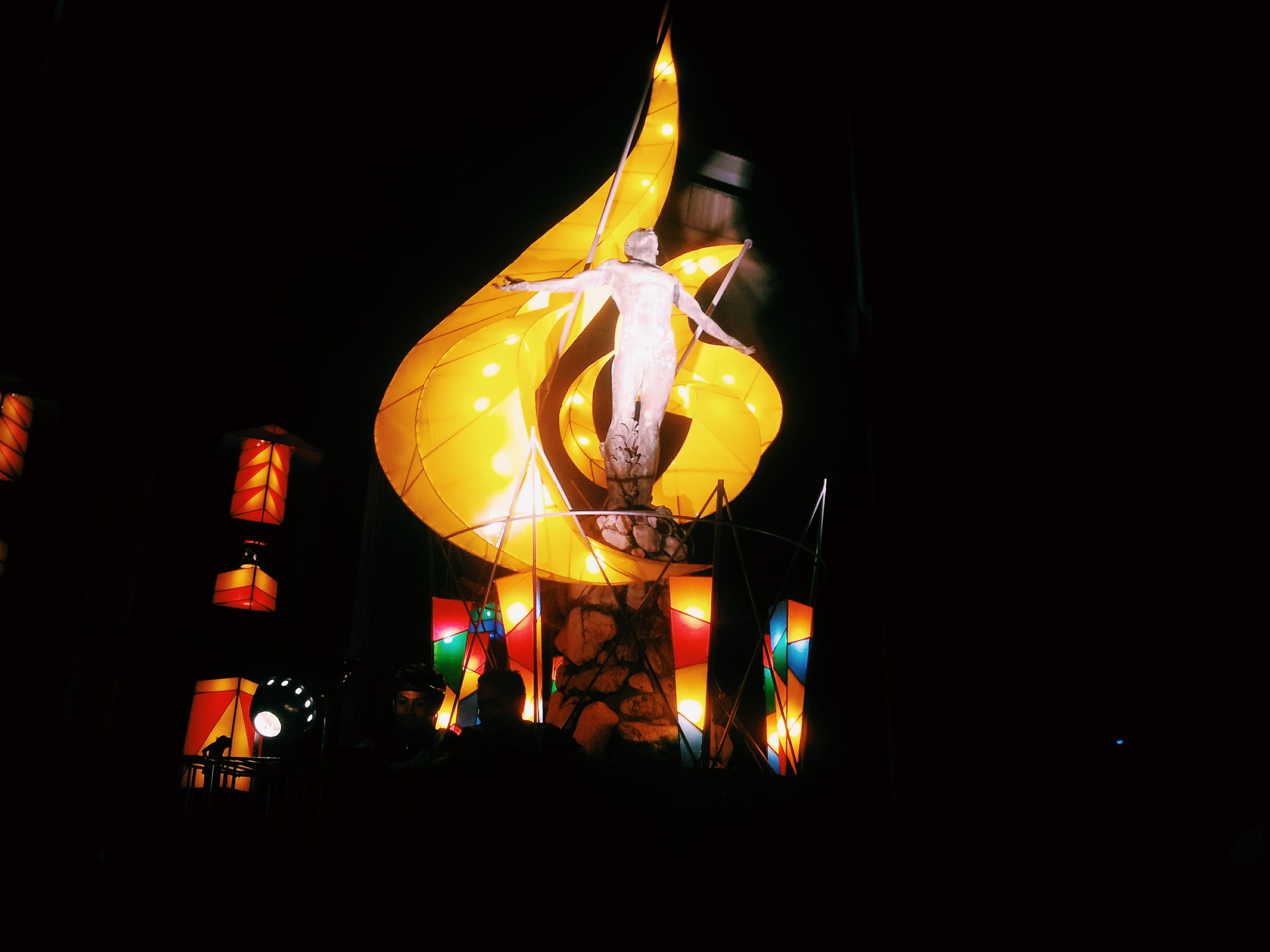 illuminated, night, glowing, dark, religion, celebration, arts culture and entertainment, place of worship, cultures, spirituality, burning, fire - natural phenomenon, tradition, flame, lighting equipment, lantern, human representation, copy space, light - natural phenomenon, low angle view