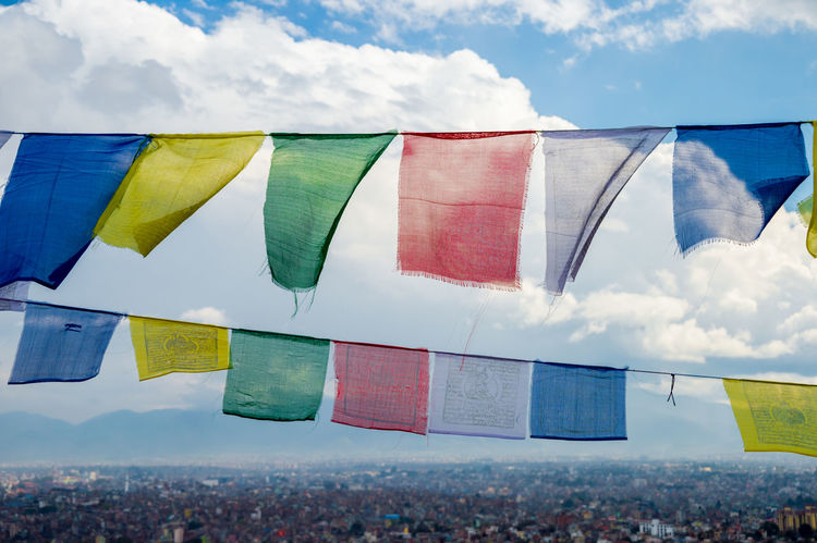 View of Kathmandu Valley from Swayambhunath Monkey temple in Nepal with colorful prayer flags in the foreground Celebration Cloud - Sky Day Flag Hanging Kathmandu, Nepal Large Group Of People Lifestyles Multi Colored Nature Outdoors Patriotism Plant Praying Sky Winter