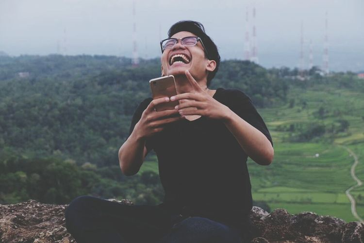 Laughing is possible answer to be understood by all of the people from any place in this earth One Person Smiling Happiness Young Adult Laughing Laughing Out Loud