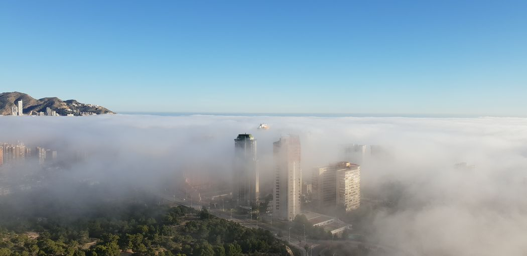 Panoramic Shot Of Foggy Weather Against Blue Sky
