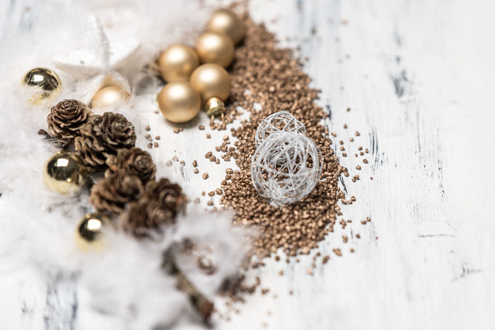 white and gold rustic, calm, bright background Backgroun White Gold Golden Calm Fether Light Symbolic  Card Wooden Rustic Tradition EyeEm Selects Christmas Decoration Studio Shot Christmas Table Close-up Bauble Christmas Ornament Christmas Bauble Ornament Decorating The Christmas Tree