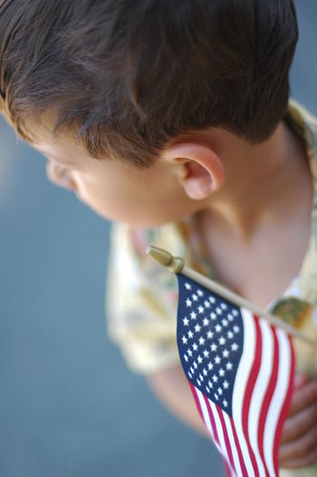 Boy with American Flag American Flag Boys Childhood Close-up Focus On Foreground Fourth Of July Hope Independence Day Innocence Looking Away Patriotic Patriotism Red White And Blue Toddler