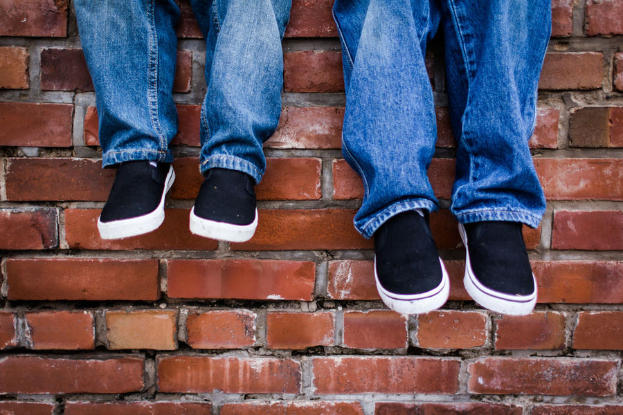 Body Part Boys Brick Brick Wall Casual Clothing Day Human Body Part Human Leg Jeans Lifestyles Minimal Outdoors People Real People Shoe Standing Togetherness Wall Wall - Building Feature This Is Family