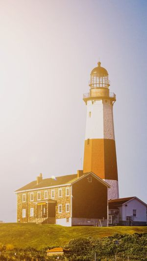 Low angle view of lighthouse against buildings