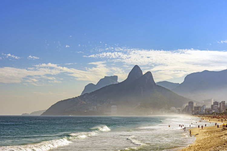 View of Ipanema beach at summer day with the Twoo Brothers hill and Gavea stone at background Brazil City Coastline Ipanema Beach Rio De Janeiro Two Brothers Hill Beach Beauty In Nature Buldings Clouds Day Gávea Stone Mountain Nature Ocean Outdoors Reopical Scenics Sea Seascape Sky Summer Urban Water Wave