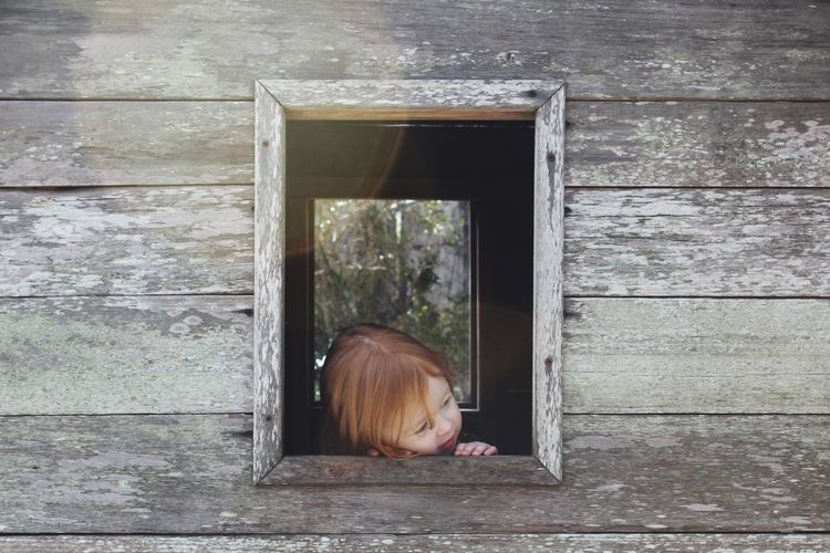 Peek a Boo Bermuda Playing Toddlerlife Daddydaughtertime Redhead Aquarium Window One Person Wood - Material Young Adult House Day Real People Young Women Indoors  Building Exterior Architecture One Young Woman Only
