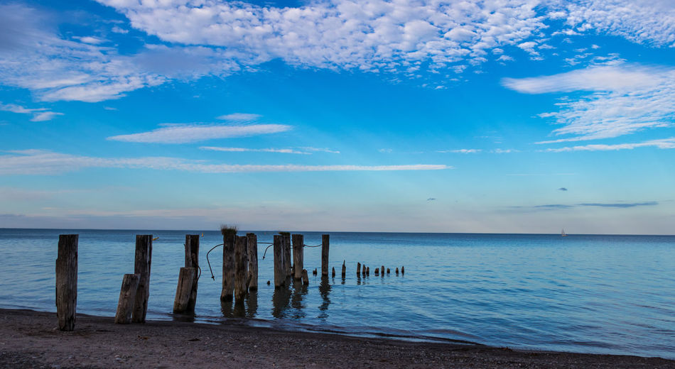 Go Away Water Sky Horizon Tranquil Scene Beach Nature Blue No People Wooden Post Beauty In Nature Scenics - Nature Horizon Over Water Outdoors Land Tranquility First Eyeem Photo