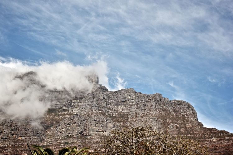 Scenic view of clouds over table mountain against sky