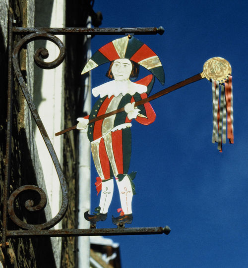 A shopkeepers sign - Boulogne, France 18th Century Style Boulogne Sur Mer Shop Sign Close-up Day Hanging Hope Low Angle View Luck Medieval Courtier No People Outdoors Religion Sky Spirituality
