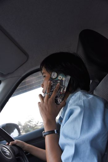 Business Cellphone Driving Traffic Woman Activity Car Car Interior Holding Indoors  Land Vehicle Leisure Activity Lifestyles Mobile Phone Mode Of Transportation Motor Vehicle One Person Photography Themes Portrait Real People Technology Transportation Vehicle Interior Wireless Technology