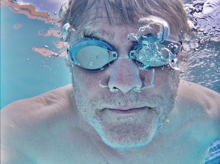Portrait of man swimming in pool
