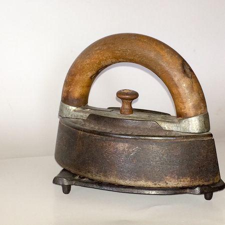 Super Retro, wood stove iron, antique iron, wood handle, rusty base, clear background