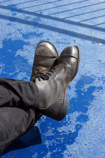 Steeltip Boots Worker Labour Blue Sitting Man Shadow Fence Shadow Fresh On Eyeem  Worker Boots Leather Boots Taking A Break TakeoverContrast