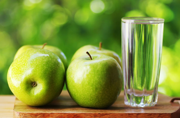 fresh green apples and glass of water Green Apples  Apple Apple - Fruit Close-up Food Food And Drink Freshness Fruit Glass Green Color Healthy Eating Table