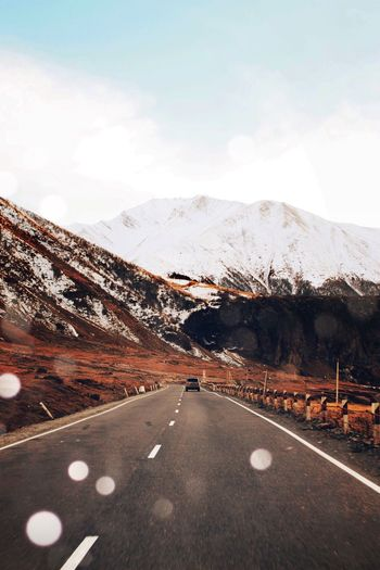 My Year My View Road Transportation Mountain The Way Forward Landscape Sky Nature Snow Scenics No People Mountain Range Winter Day Beauty In Nature Cold Temperature Tranquility Mountain Road Winding Road