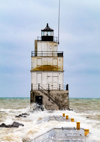 November Waves Along Lake Michigan Lighthouse Manitowoc Wisconsin Architecture Beach Beauty In Nature Building Exterior Built Structure Cloud - Sky Day Horizon Over Water Lighthouse Motion Nature No People Outdoors Sea Sky Tower Water Wave