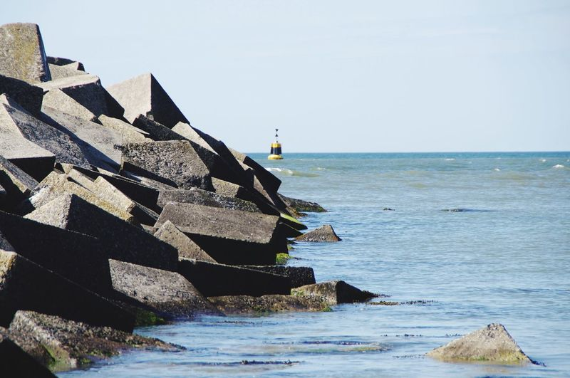 Seawall Buoy Stone Rocks Water Sea Sky Horizon Over Water Horizon Nature Day Scenics - Nature Beauty In Nature Built Structure No People Solid