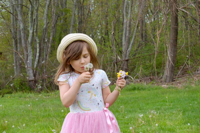 Full length of a girl holding flower