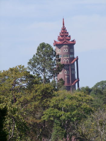Tower viewed from National Kandawygi Gardens Aarchitecture Blue Sky White Clouds Buddhist Architecture Composition Fun Myanmar National Gardens National Kandawygi Gardens Outdoor Photography Pyin Oo Lwin Sunlight Tower Tower Architecture Travel Destination Tree Unusual Unusual Architecture