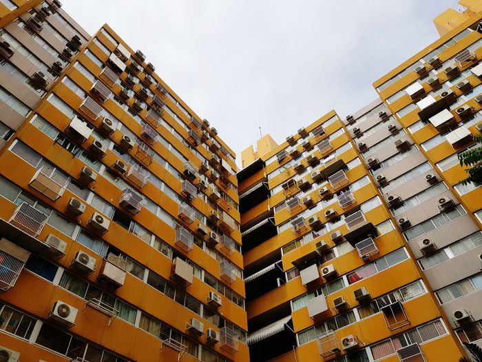 Low angle view of yellow buildings in city