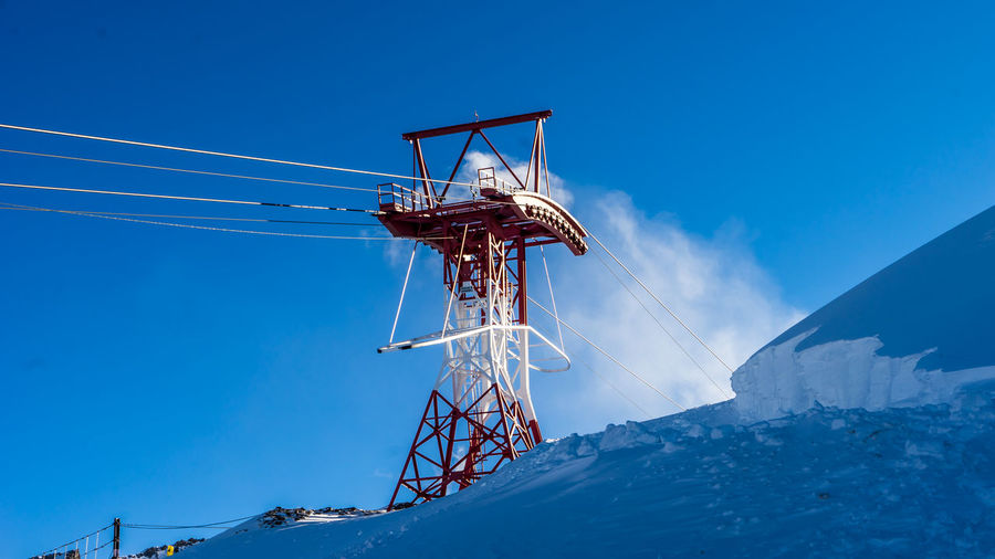 Cable Car Blue Cable Clear Sky Cold Temperature Day Fuel And Power Generation Kitzsteinhorn Low Angle View Nature No People Outdoors Powder Snow Sky Snow Technology Winter Zell Am See Shades Of Winter