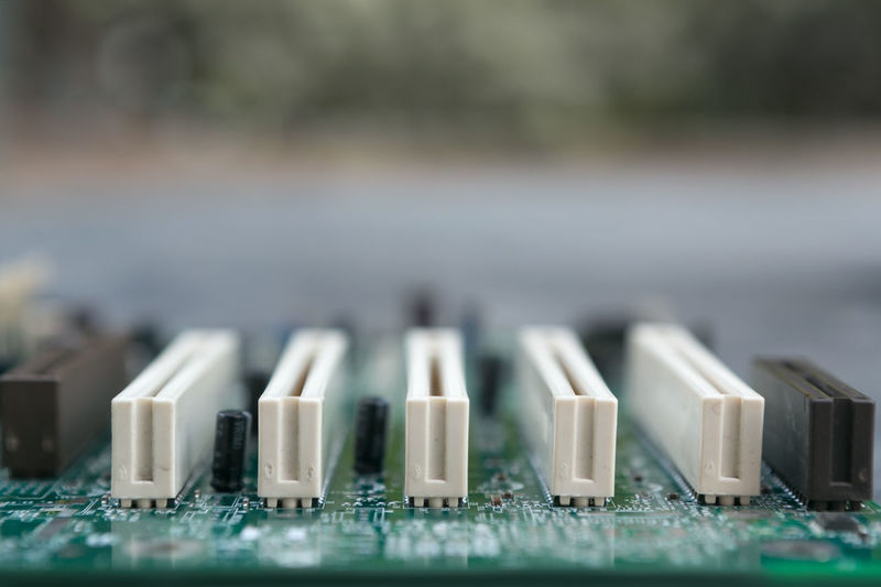 Shallow DOF View of a Computer Motherboard Chip Technology Computer Chip Connection No People Electronics Industry Circuit Board Close-up Electrical Equipment Complexity Information Computer PC Motherboard Green Cryptocurrency Encryption Future Obsolete Data Bitcoin Internet Communication Virtual Reality Nanotechnology Binary Code