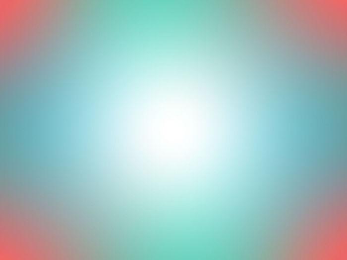 Defocused image of illuminated bright against blue sky