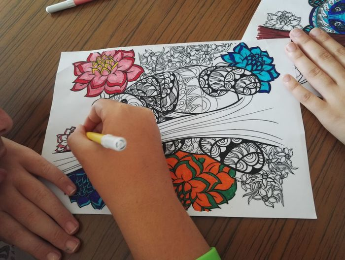 High angle view of child coloring on table