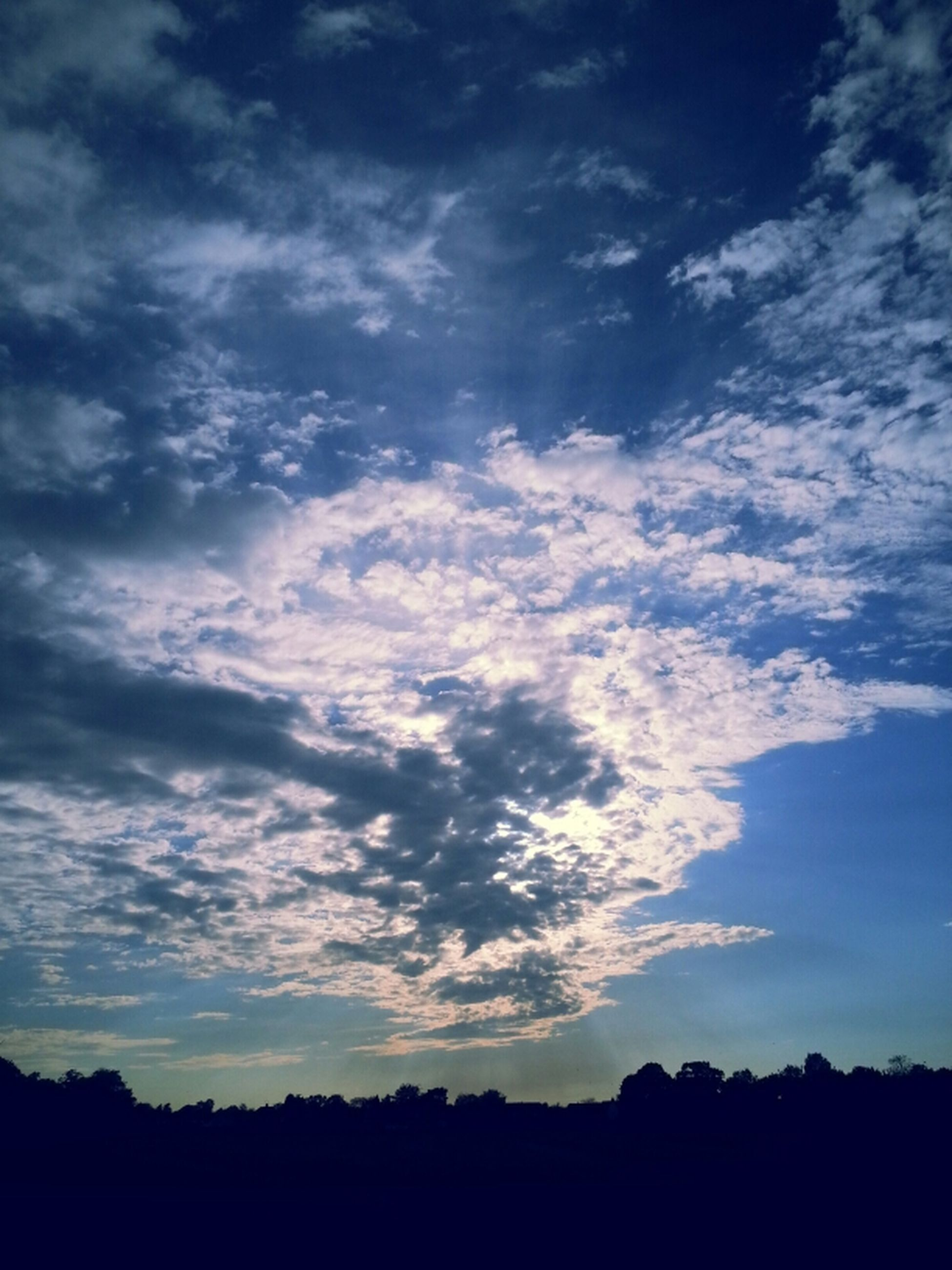 silhouette, sky, tranquility, tranquil scene, scenics, beauty in nature, cloud - sky, nature, landscape, tree, cloud, idyllic, sunset, blue, low angle view, dark, outline, cloudy, dusk, outdoors