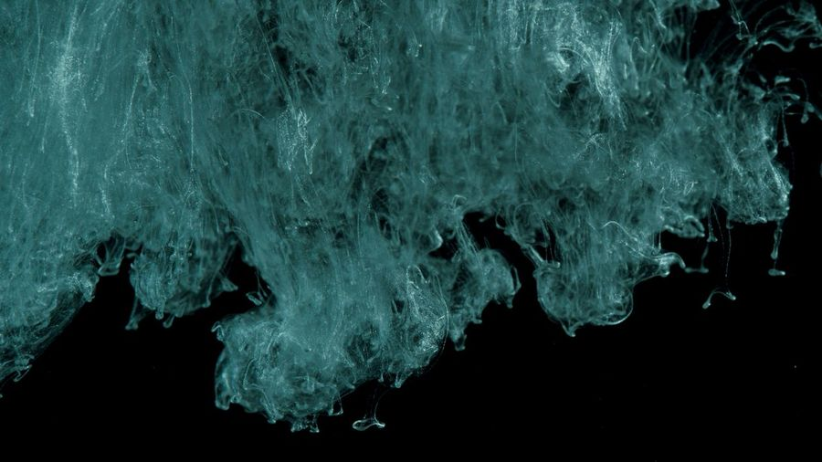 Ink in water. Turquoise with silver glitter paint reacting in water creating abstract cloud formations.Can be used as transitions,added to modern projects,art backgrounds, anything with creative twist Water Abstract No People Nature Indoors  Night Studio Shot Textured  Sea Close-up Motion Black Background Dark Cold Temperature Backgrounds Splashing Winter Illuminated Abstract Backgrounds