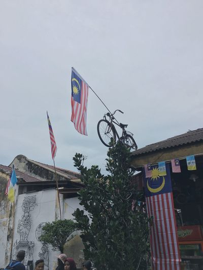 Describe creativity Malaysia Scenery Malaysia Truly Asia Malaysian Food Penang ShotOnIphone Flag Sky Low Angle View Patriotism Nature Day
