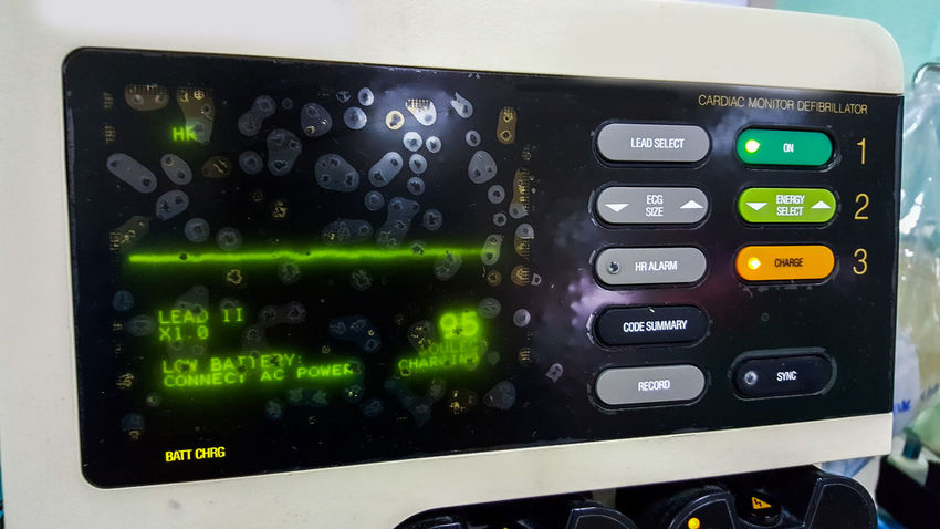 Defibrillator. Cable Close-up Communication Connection Control Control Panel Defibrillator Device Screen Emergency Green Color Hospital Medical Meter - Instrument Of Measurement Number Old-fashioned Optical Instrument Resuscitation Technology