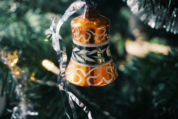 Close-up of bell hanging on christmas tree