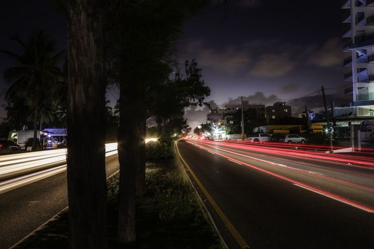 Light trails on street in city at night