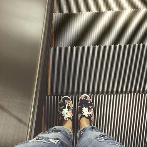 Going down Escalator Stairs Standing Shoes Ripped Jeans Going Down Subway Shopping Mall Waiting