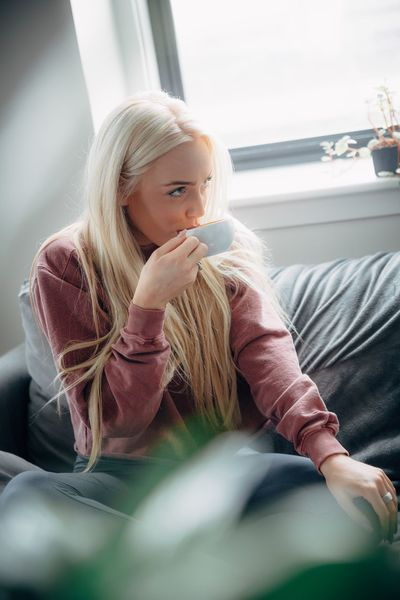 But first, coffee. Coffee Coffee Time Couch Espresso Happiness Lifestyle Morning Relaxing Blond Hair Casual Clothing Day Holding Home Interior Indoors  Leisure Activity Lifestyles Morning Rituals One Person People Portrait Real People Relax Sitting Young Adult Young Women