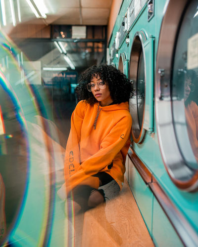 Nandippa Portrait Of A Woman Portrait Photography City Life Laundromat Laundry Prism Reflection Reflection_collection Only Women One Woman Only Adults Only One Person Adult Fashion Black Hair City One Young Woman Only Portrait Lifestyles Women Young Adult Multi Colored