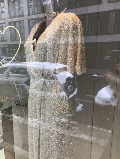 Digital composite image of wet glass window in store