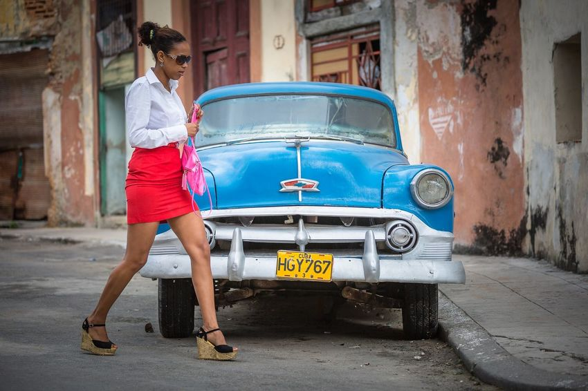 In Havana Cuba, past and present are mixed up in everyday life. Retro Classic Car People Storytelling Streetphotography Travel Cuba Havana Mode Of Transportation City Car Street Full Length Fashion Young Women