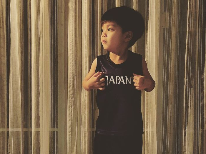 Japan Boy Childhood Child One Person Men Standing Males  Boys Casual Clothing Looking Indoors  Leisure Activity Three Quarter Length Innocence Waist Up Real People Wall - Building Feature Lifestyles Curtain