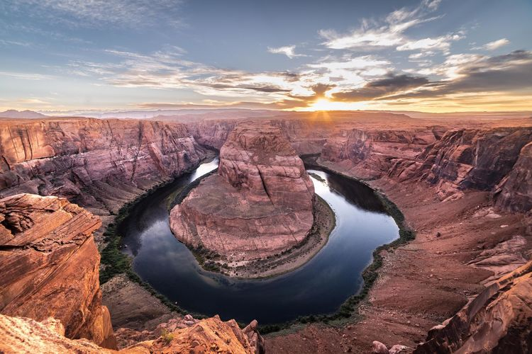 High angle view of horseshoe bend against sky during sunset