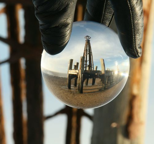 Caption This Pier Old Pier Wood Lens Ball Glass Ball Illusion Photography Close-up Hanging Indoors  No People Day