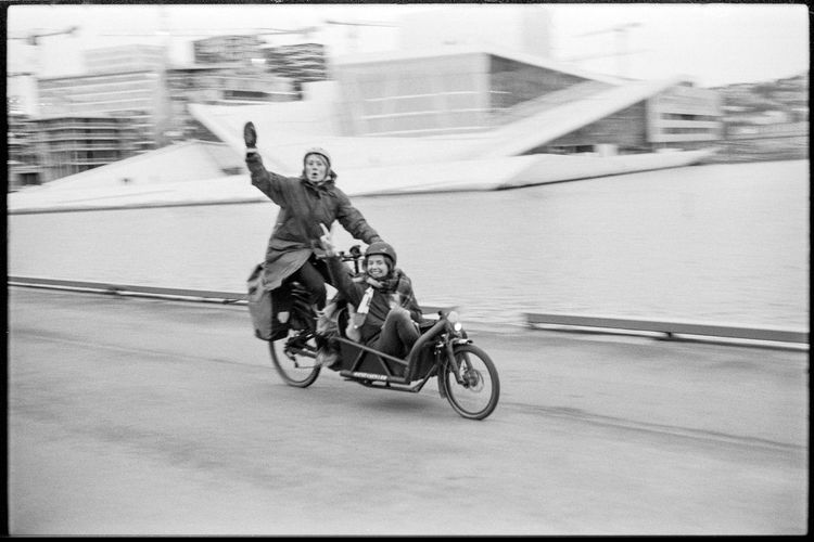 two women cycling in Oslo centre. Transportation Bicycle Mode Of Transportation Real People Leisure Activity Outdoors Streetphotography Streetphoto_bw Analogue Photography Analogue Film Photography Filmisnotdead 35mm 35mmfilmphotography Playful Women Bnw Human Connection
